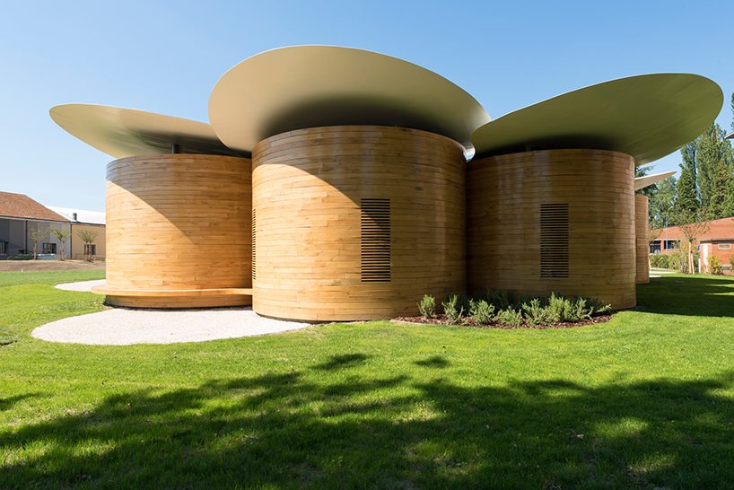 A cluster of nine small circular music laboratories form the new distinctive house of music in Bologna